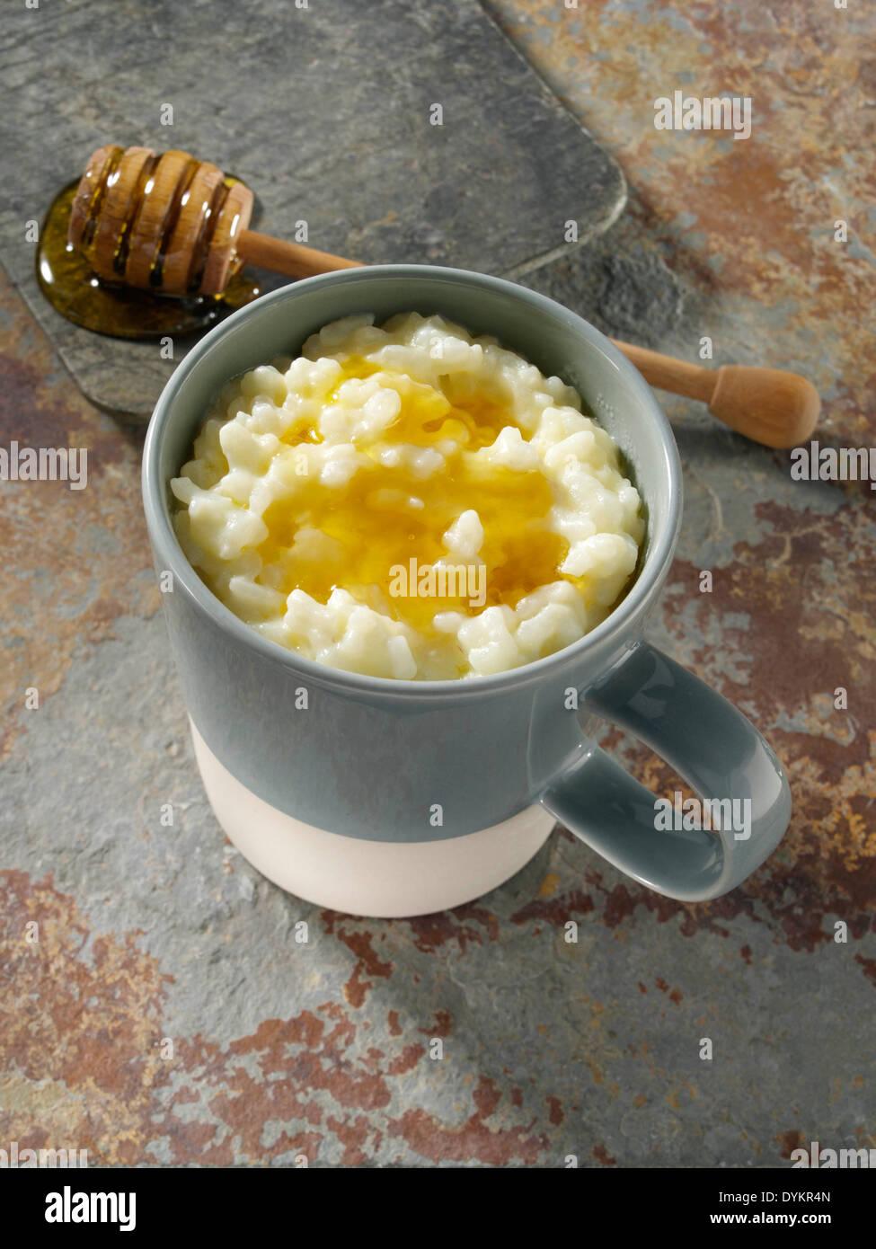 Rice pudding microwaved in a mug dessert - Stock Image