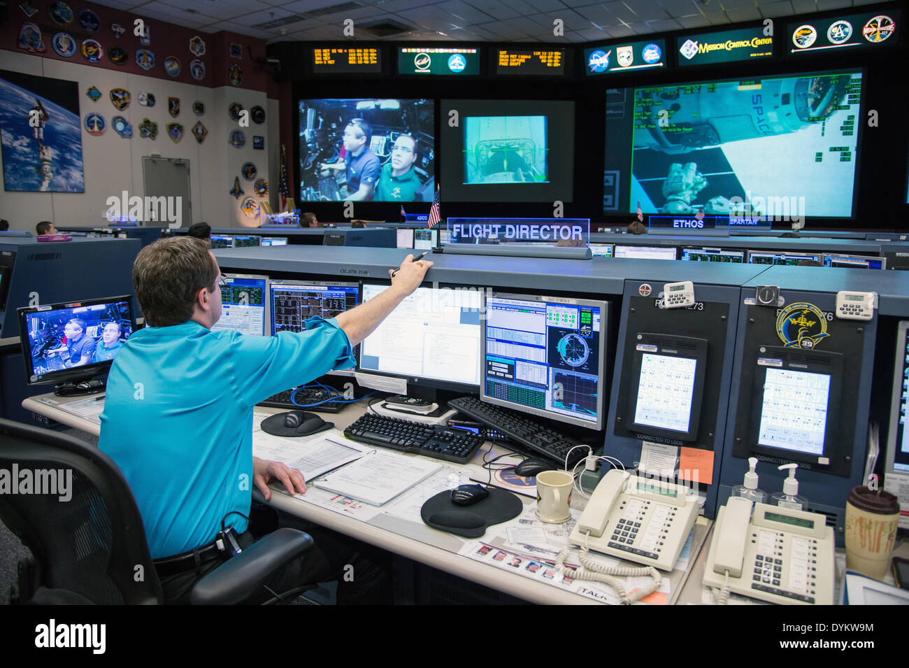 Mission Control Monitor : Nasa flight director matt abbott monitors the spacex