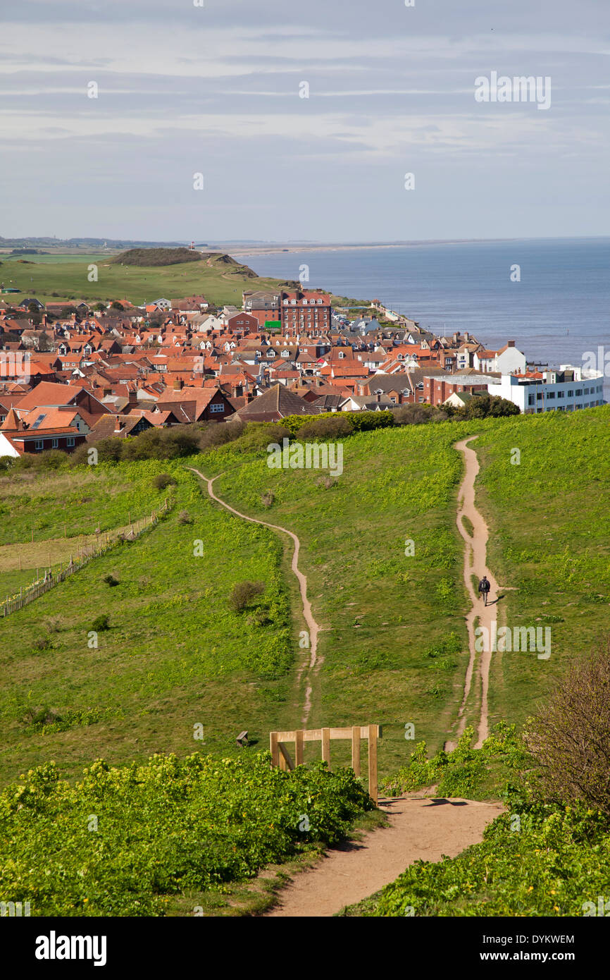 One of Sheringham's clifftop footpaths, with distant view of town's golf course and neighbouring Weybourne - Stock Image