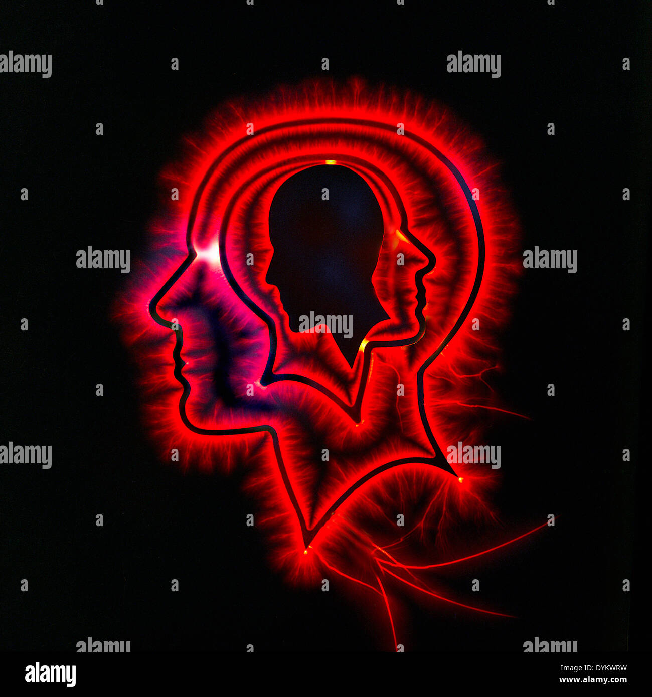 Photo illustration of head with red glow. - Stock Image