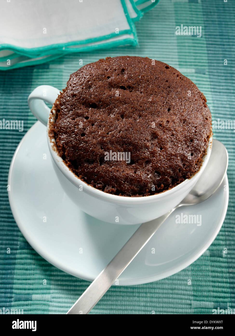 Squidgy chocolate cake microwaved in a mug dessert - Stock Image