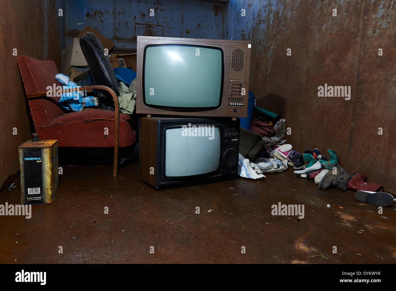 Retro old vintage tv television with pile of rubbish in ...