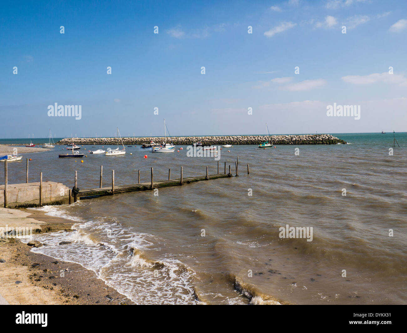 Sea Front and Harbour Rhos-on-Sea Conwy North Wales with offshore wind turbines generating energy on a lovely summers Stock Photo