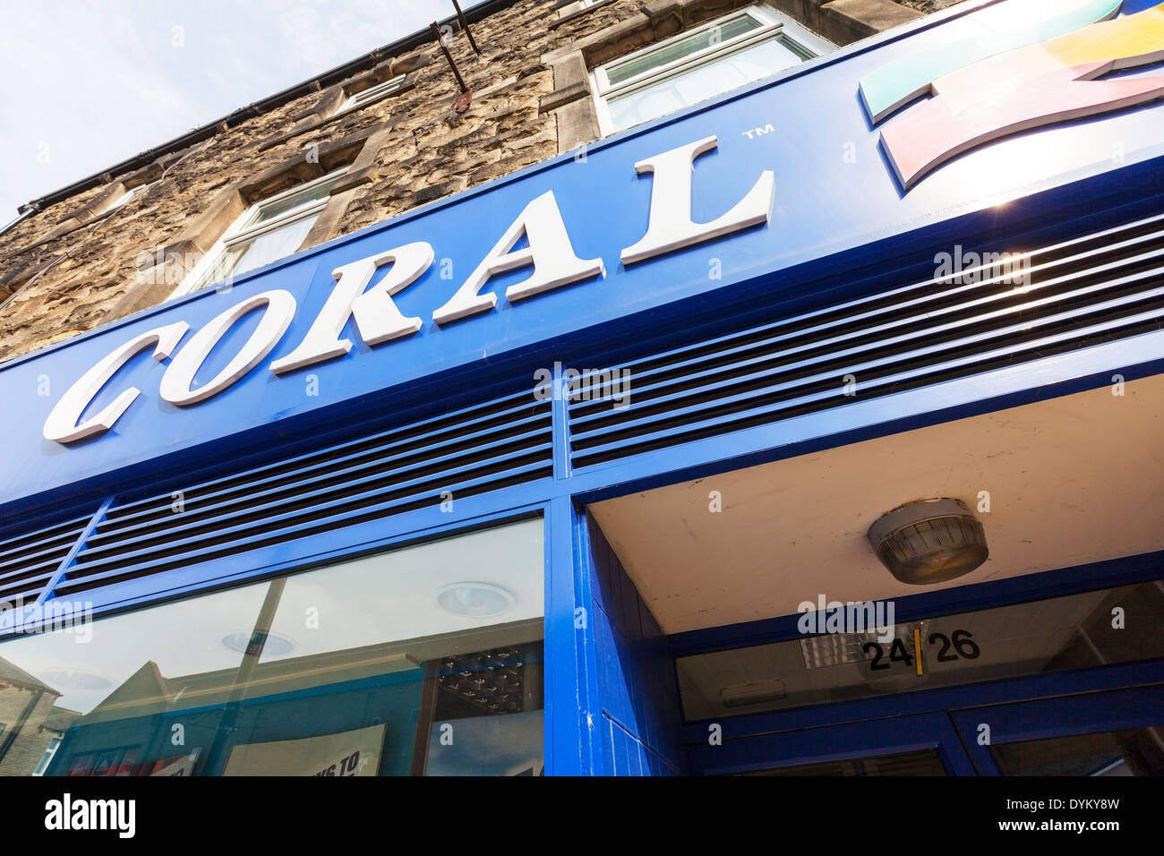 Coral shop sign bookmakers bookies betting gambling high street shops Skipton Town Yorkshire Dales National Park, UK England - Stock Image