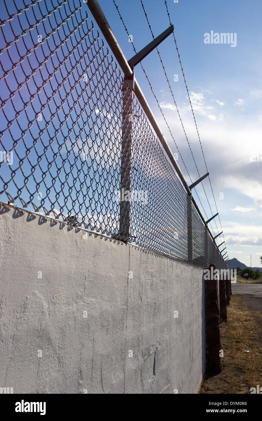 Wall and security fence. - Stock Image