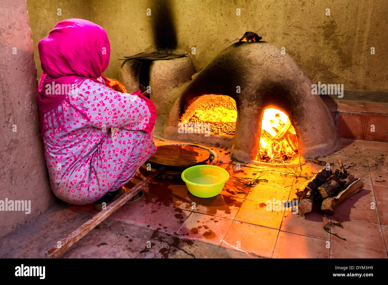 An Moroccan woman making traditional bread in an wood-burning oven, Scoura, Morocco, Africa - Stock Image