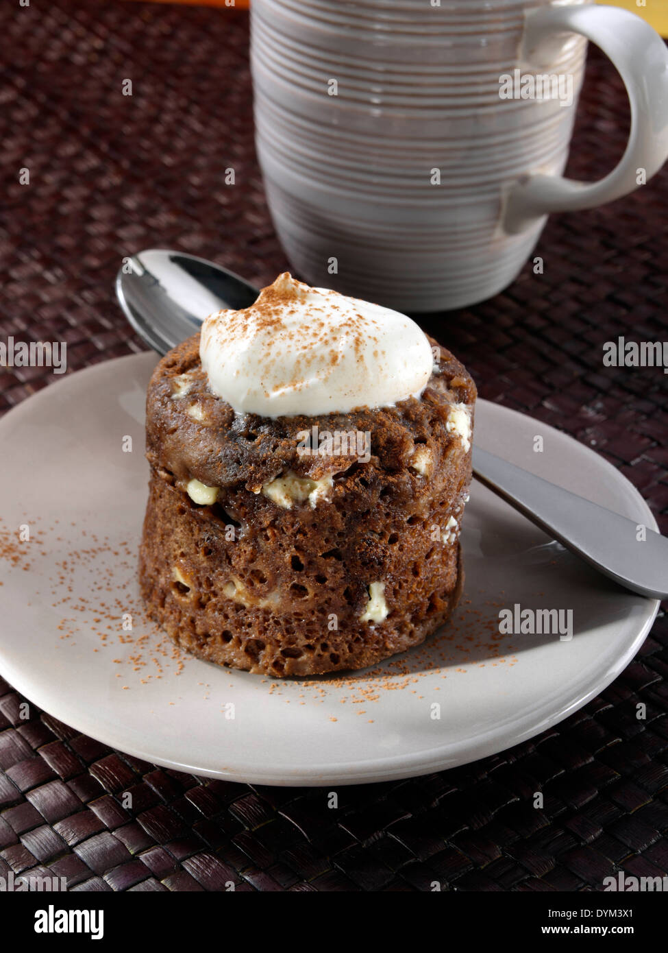 Microwaved chocolate pudding in a mug - Stock Image