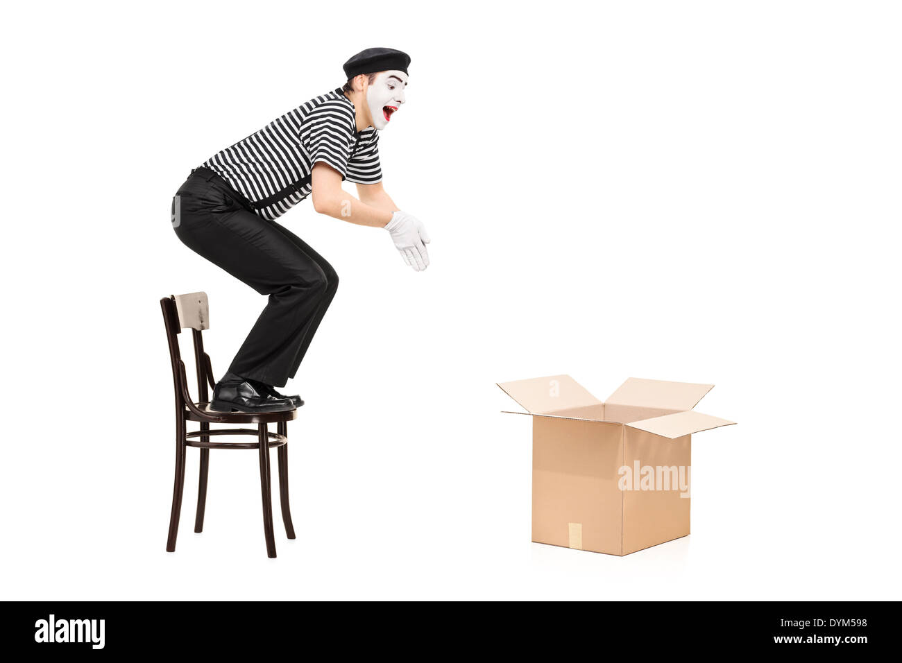 Mime artist jumping in an empty box - Stock Image
