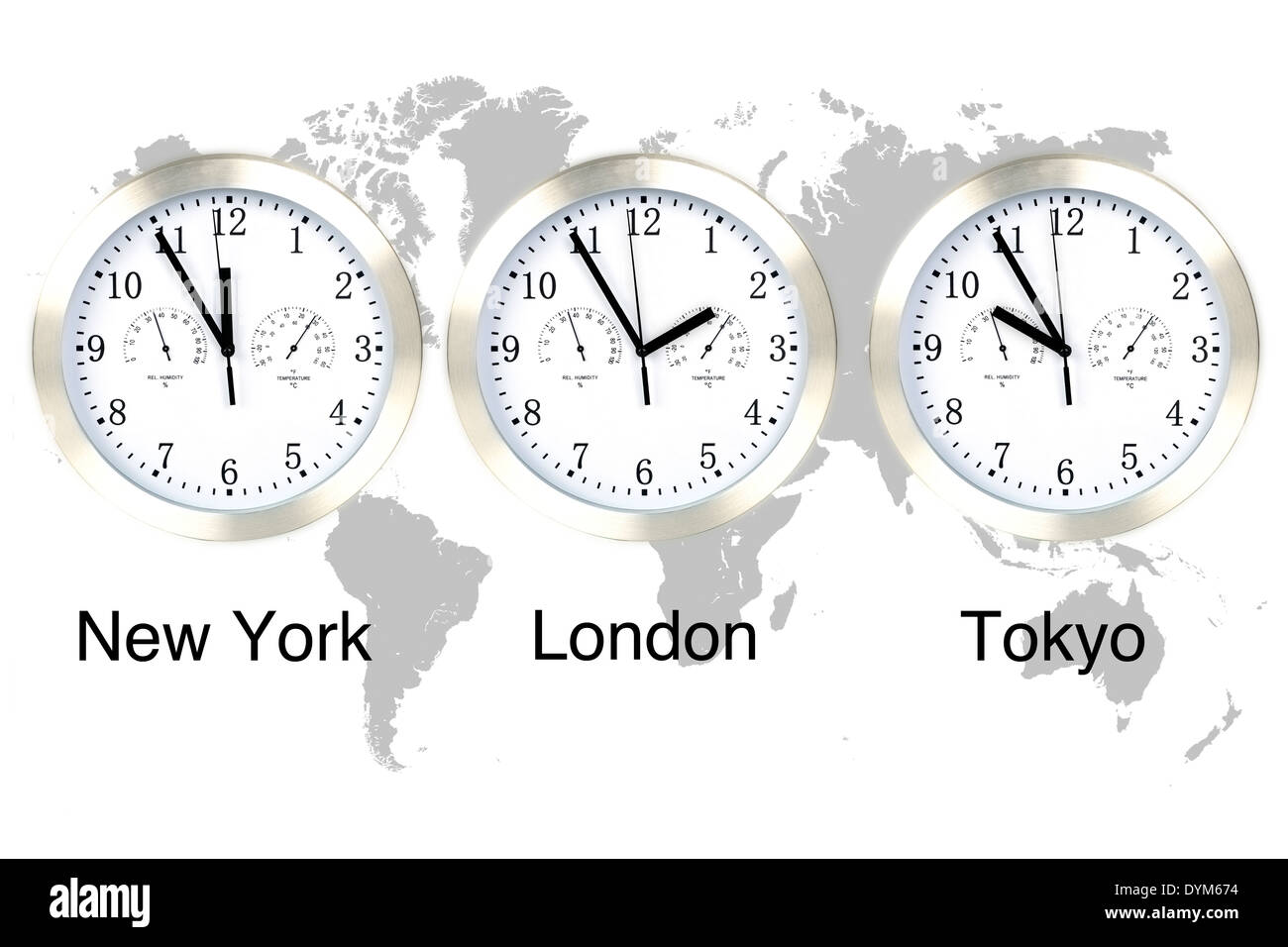 World time zones. Time in London, New York and Tokyo, three clocks against grey world map. - Stock Image