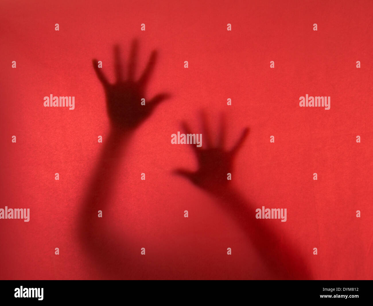 Trapped. Ghostly hands reach out to the camera. - Stock Image
