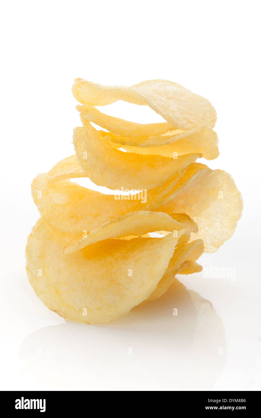 Crispy crisps stack isolated on white background. Unhealthy junk food eating concept. - Stock Image