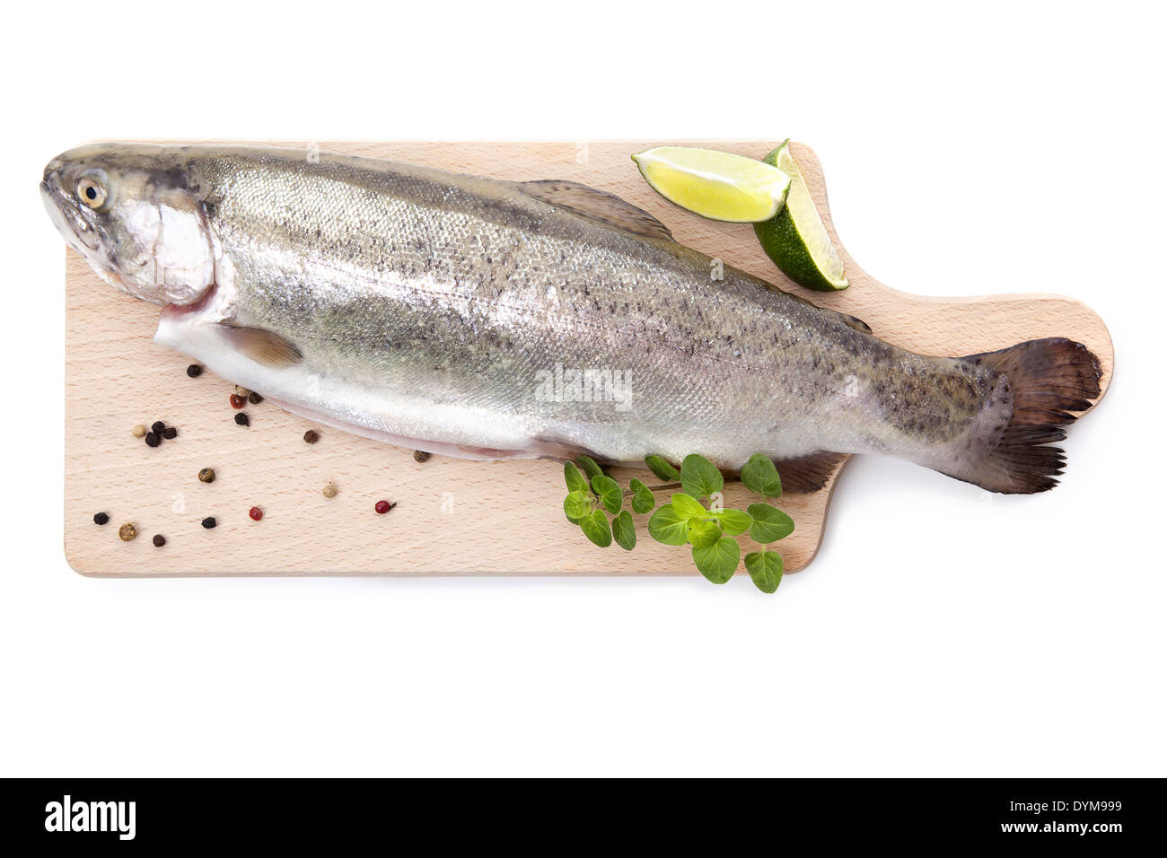 Fresh raw trout with pepper and fresh herbs on wooden cutting board isolated on white background, top view. Culinary - Stock Image