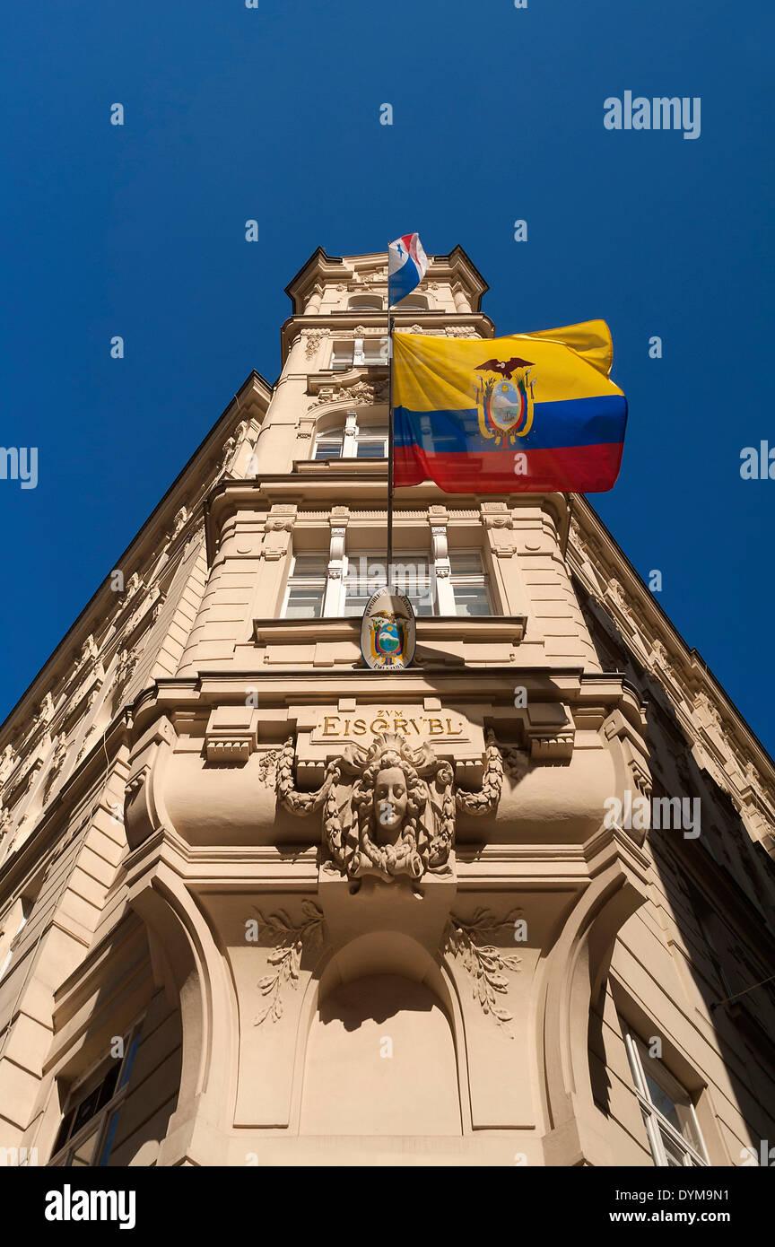 "Former building ""Zum Eisgrübl"", 19th century, now Embassy of the Republic of Ecuador, with national flag flying, Vienna Stock Photo"