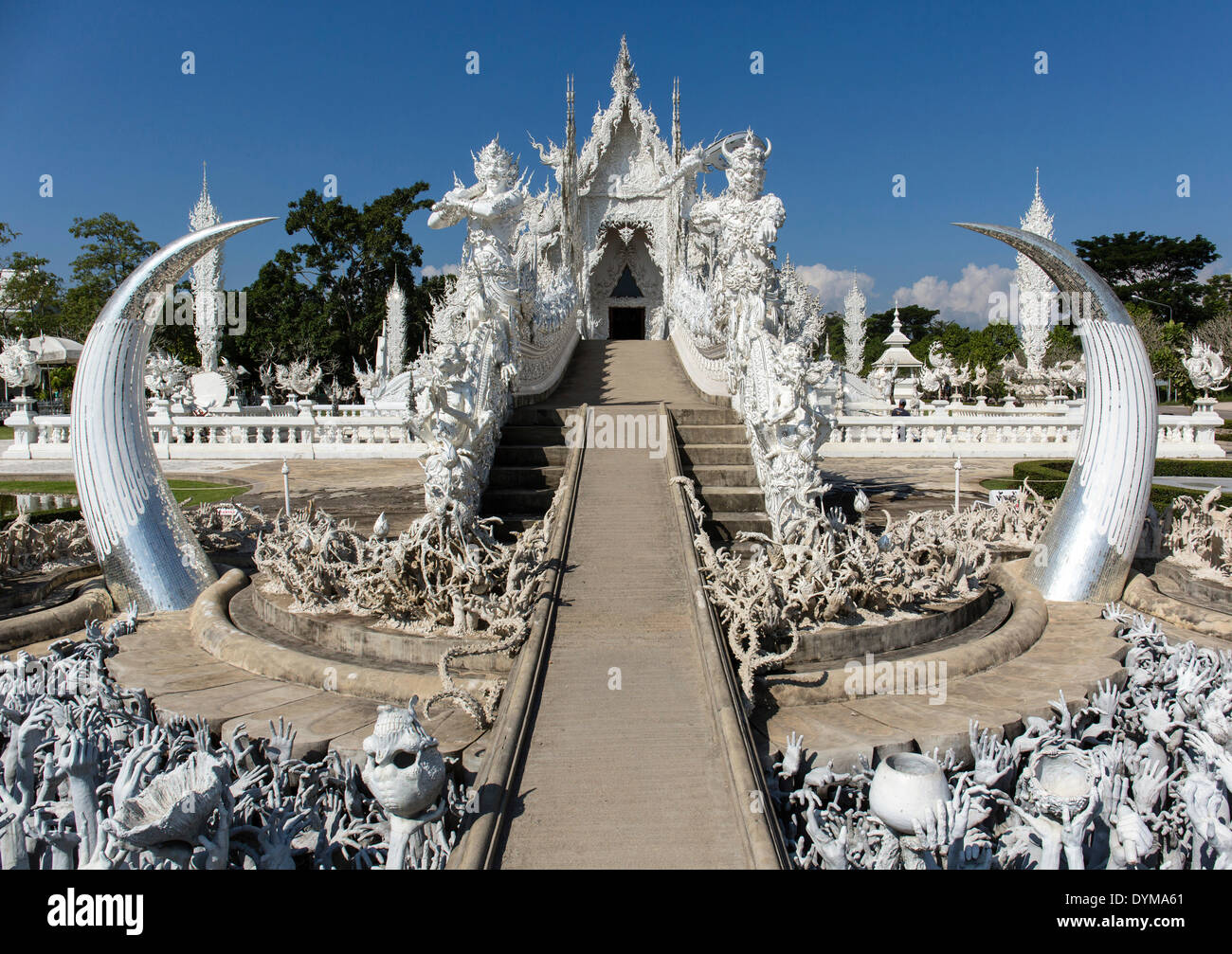 Depiction of hell, pleading hands on the stairs to the entrance of Wat Rong Khun, White Temple, by architect Chalermchai - Stock Image