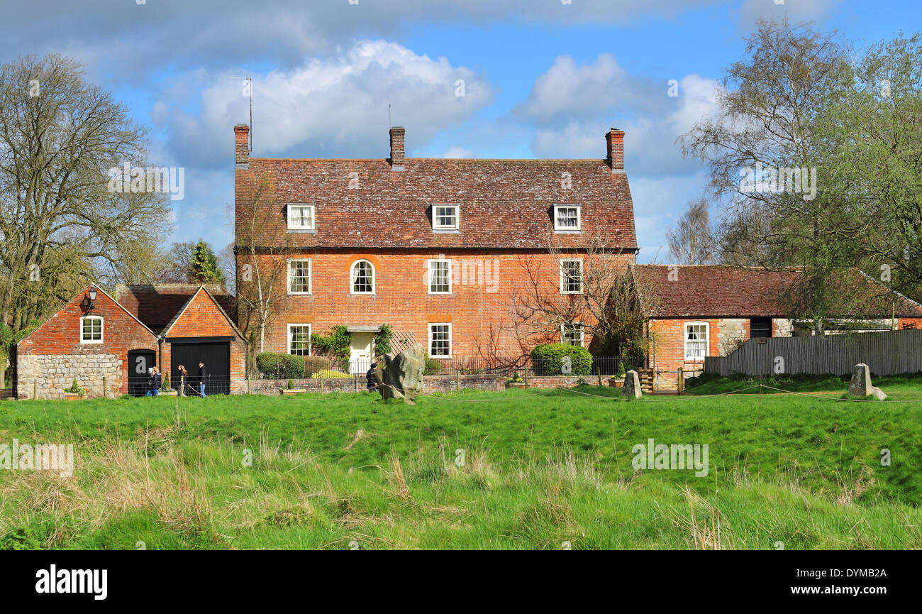 English Manor Farmhouse in Rural Wiltshire with meadow in front - Stock Image