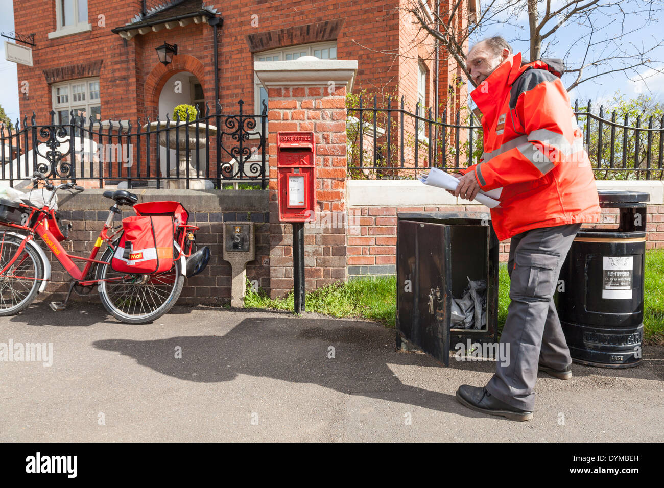 Royal Mail postman collecting post from a box prior to delivering. Nottinghamshire, England, UK Stock Photo