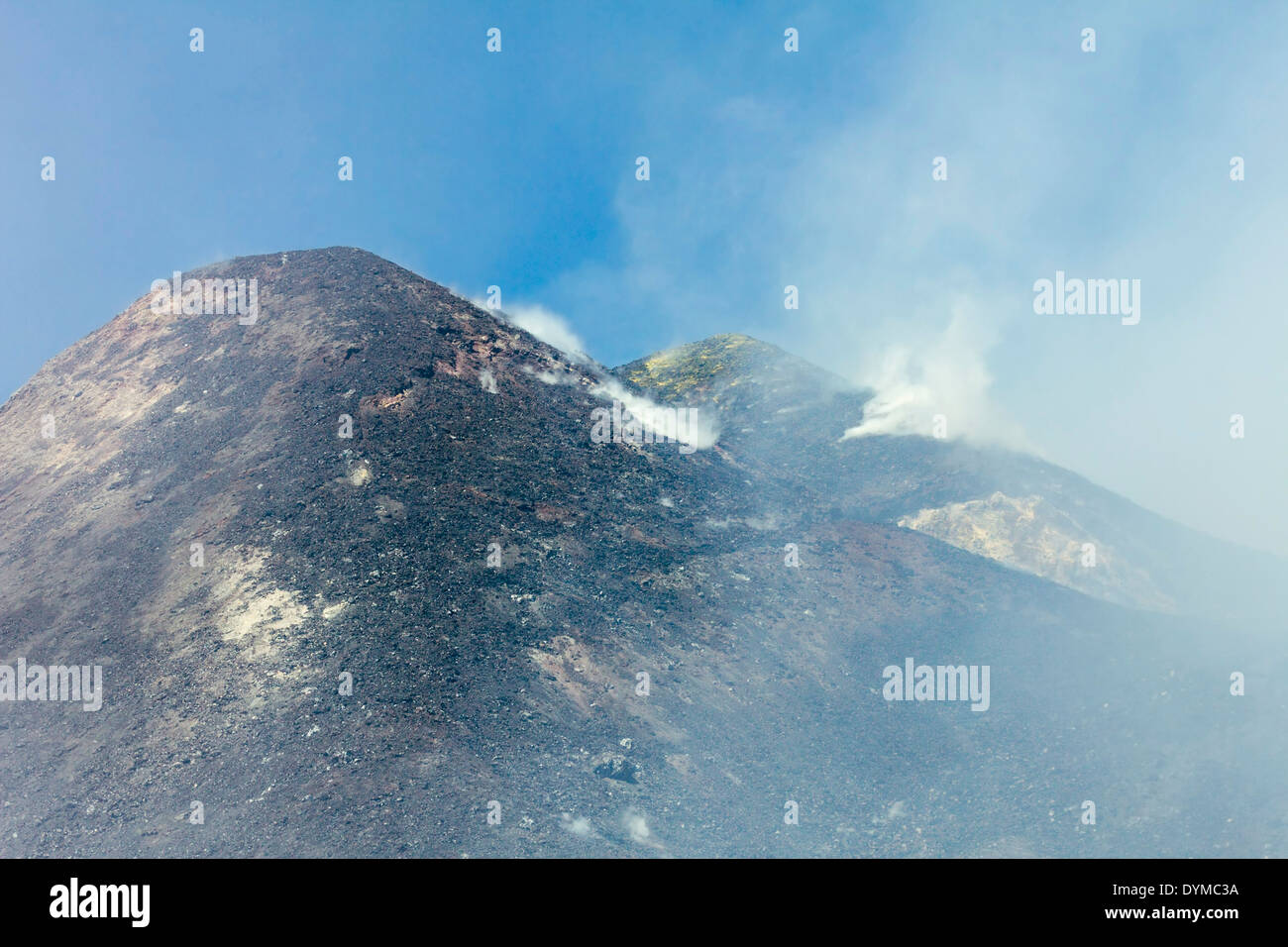 Sulpur, ash & lava rock at the smoking summit of 3350m volcano Mt Etna during an active phase; Mount Etna, Sicily, Italy - Stock Image