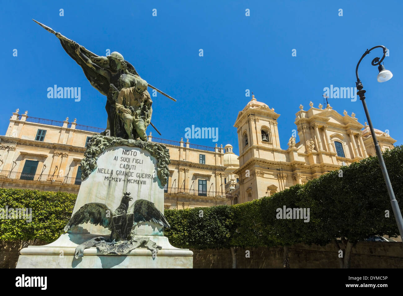 Monument to the First World War & the 17thC Cathedral, at this World Heritage Baroque architecture city; Noto, Sicily, Italy - Stock Image