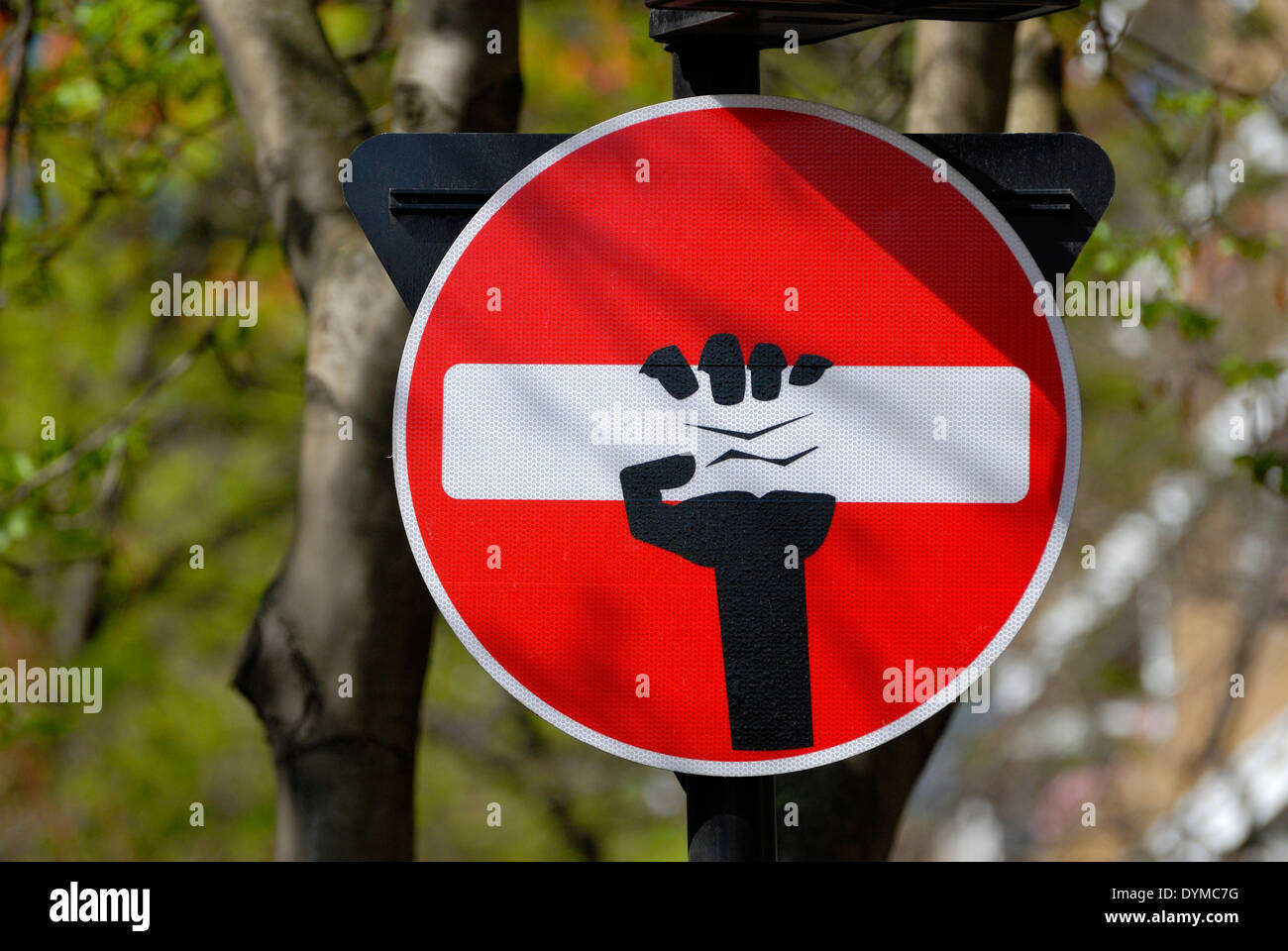 London, England, UK. Defaced traffic sign 'No Entry' near Charing Cross Road (2014) - by artist Clet Abraham - Stock Image
