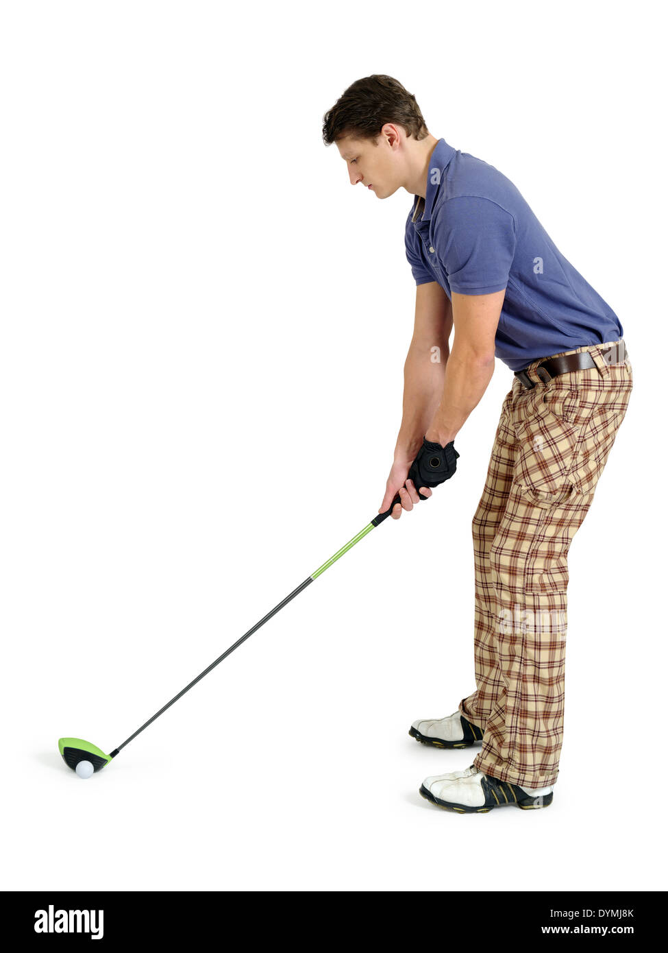 Photo of a male golfer in his late twenties about to swing his driver. - Stock Image