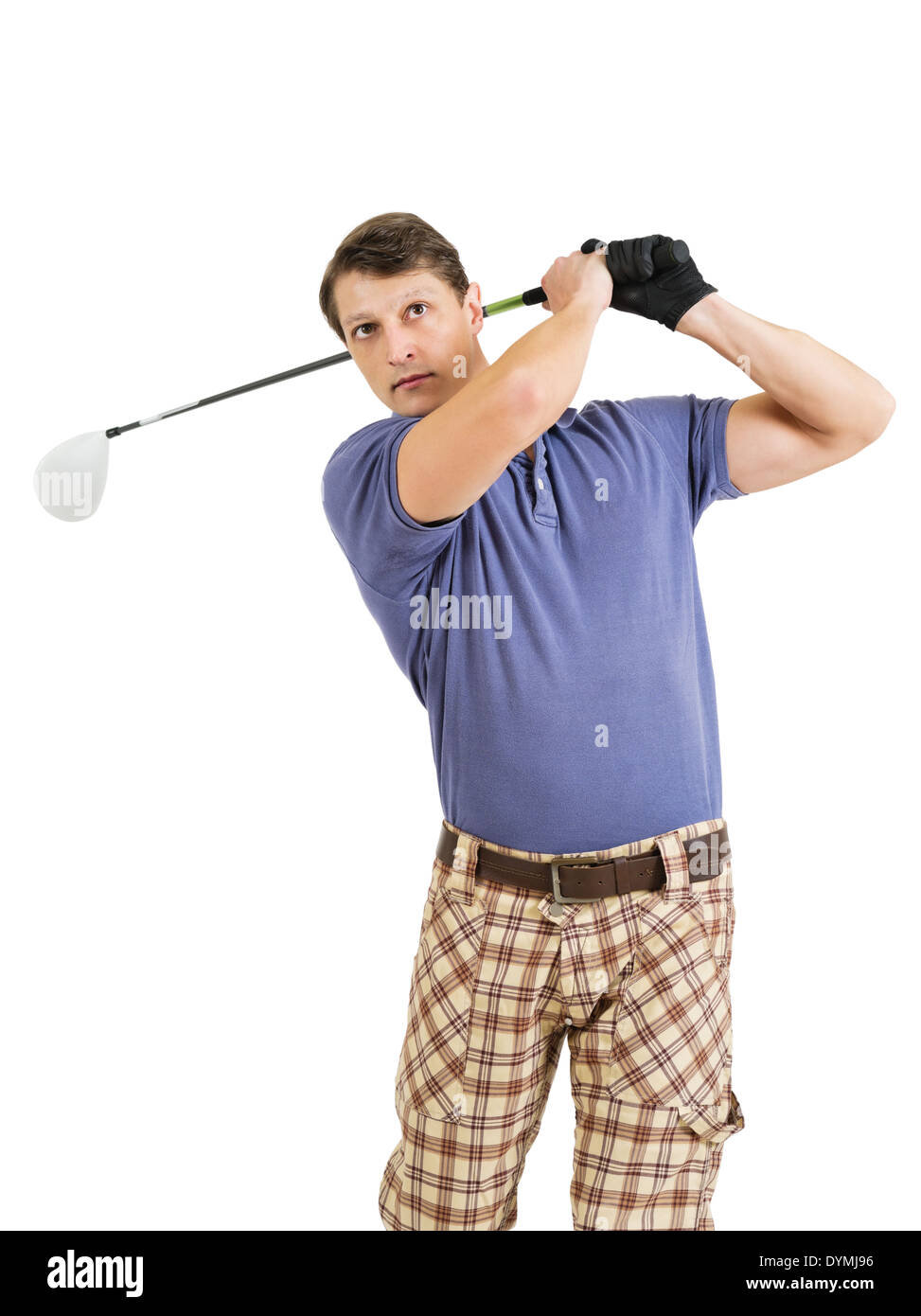 Photo of a male golfer in his late twenties finishing his swing with a driver. - Stock Image