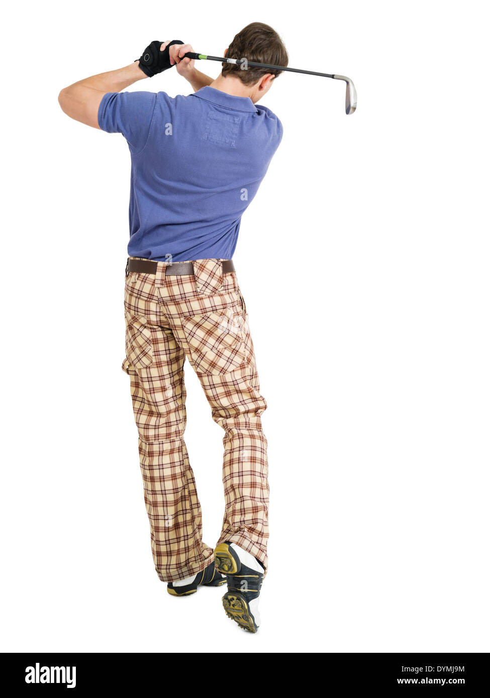 Photo of a male golfer in his late twenties finishing his swing with a wedge. - Stock Image