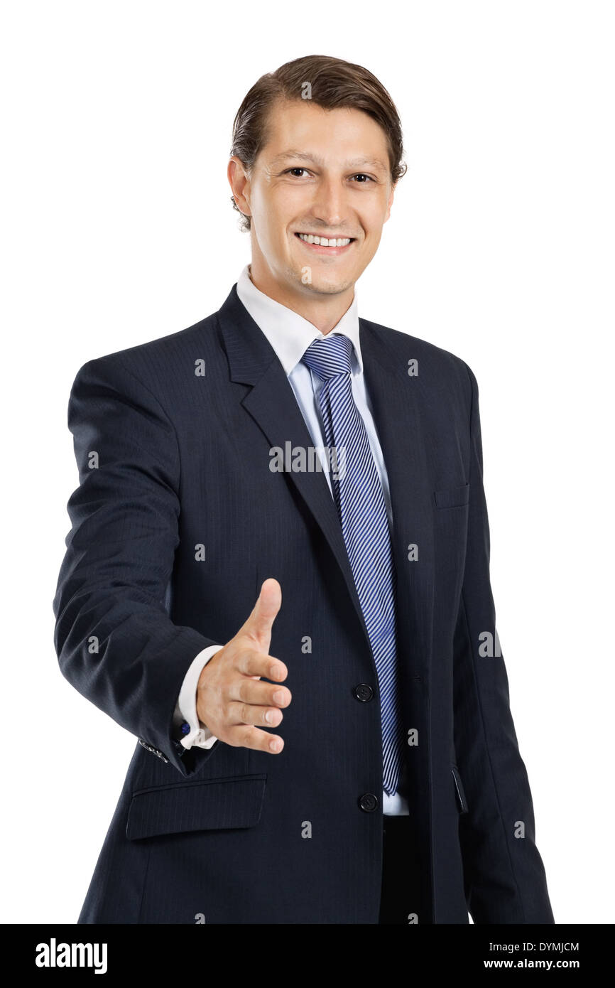 Photo of an attractive businessman in his late twenties extending his hand out. - Stock Image