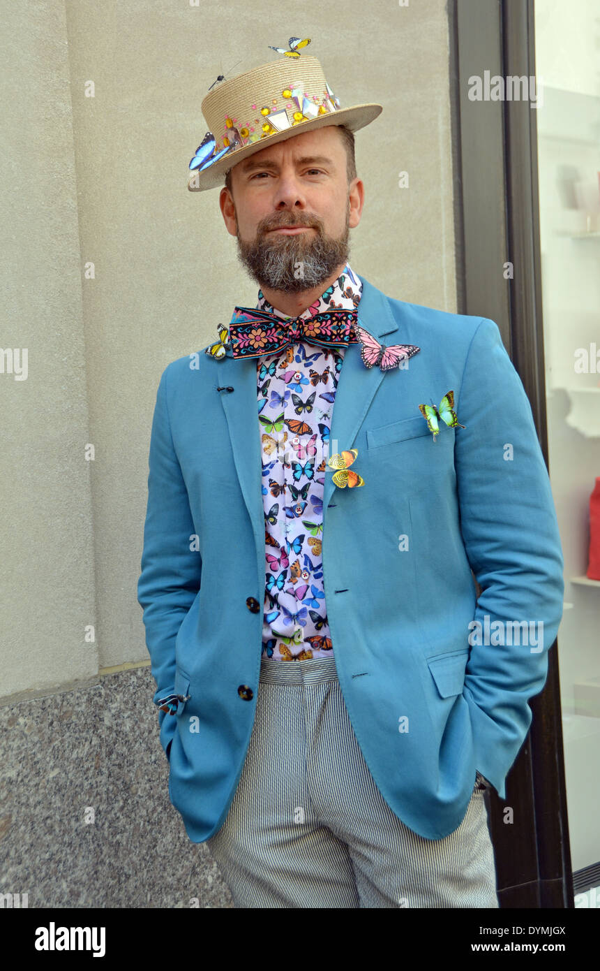 A dapperly dresses man with butterfly ornaments at the Easter Parade in Midtown Manhattan, New York City - Stock Image