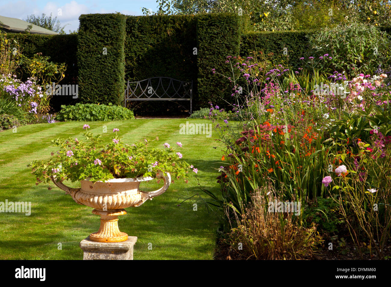 Formal English garden , with lawn surrounded by Herbaceous summer Boarders - Stock Image