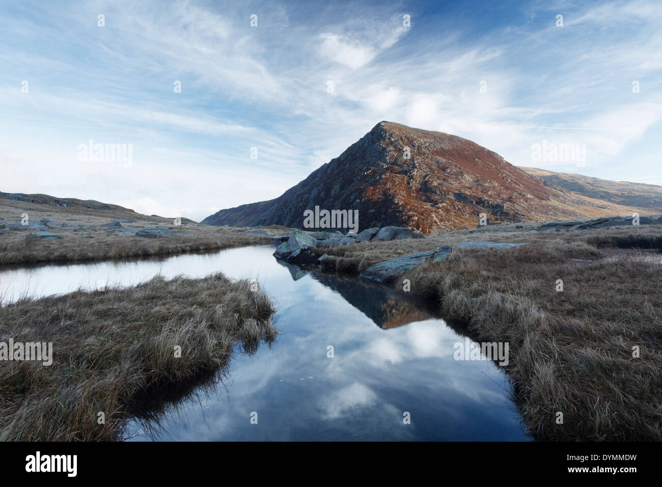 Pen yr Ole Wen reflected in the River Idwal. Snowdonia National Park. Wales. UK. - Stock Image