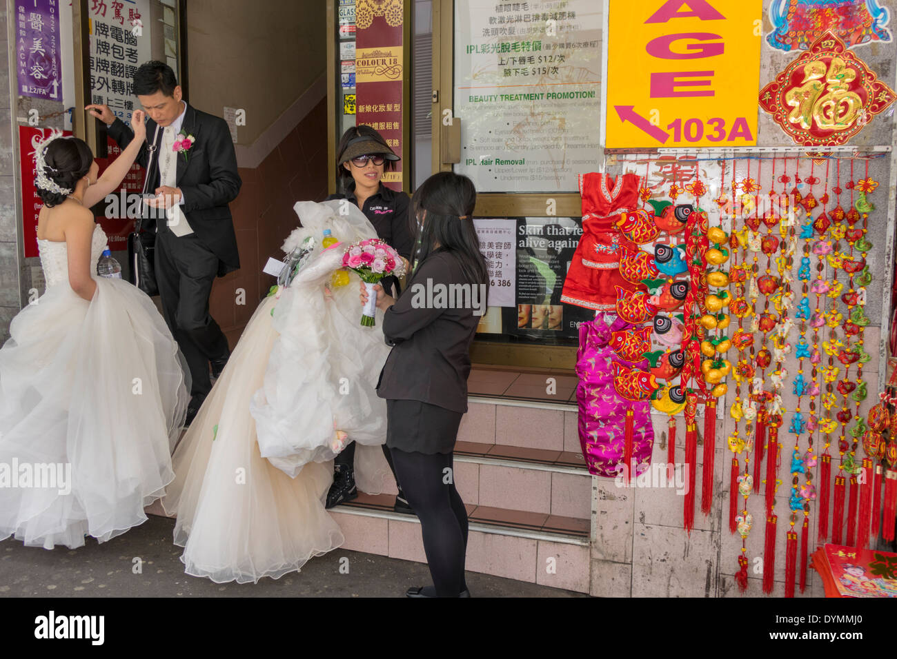 Sydney australia nsw new south wales haymarket chinatown asian woman sydney australia nsw new south wales haymarket chinatown asian woman man bride groom wedding dress white decorations sale souvenirs shopping junglespirit Choice Image