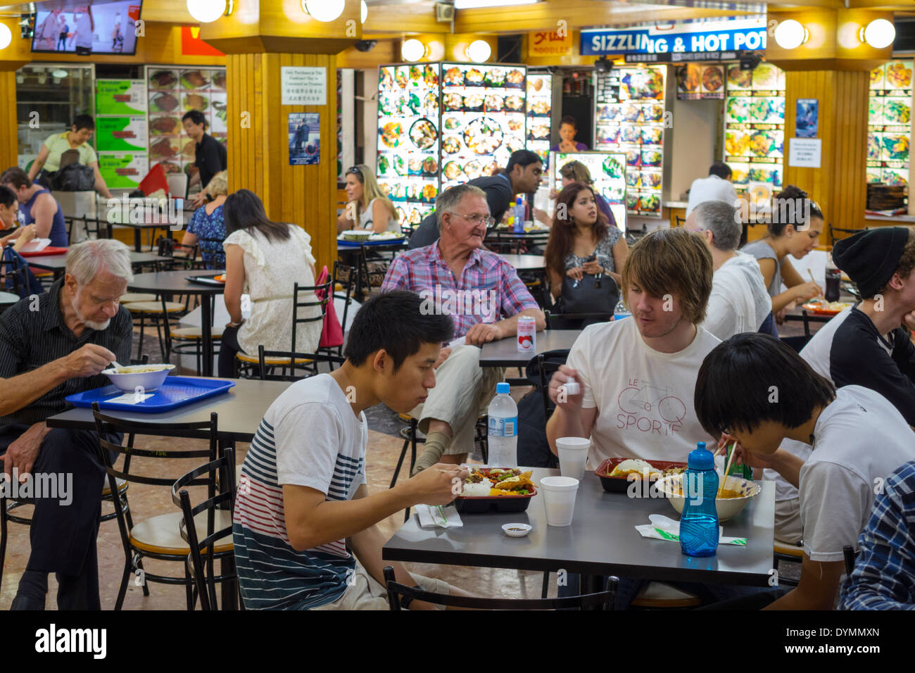 Sydney Australia NSW New South Wales Haymarket Dixon Street Dixon House Food Court Asian man friends eating dining restaurant - Stock Image