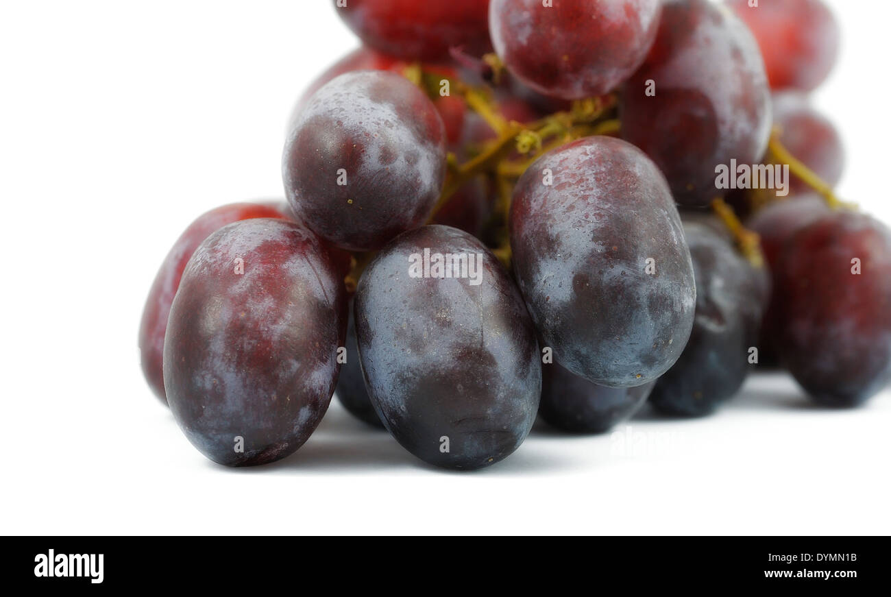 Red  grapes on a white studio background - Stock Image