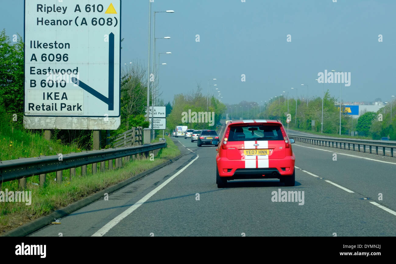 A red Ford Fiesta ST indicating to leave the dual carriageway exit near Ikea retail park Nottingham England uk Stock Photo
