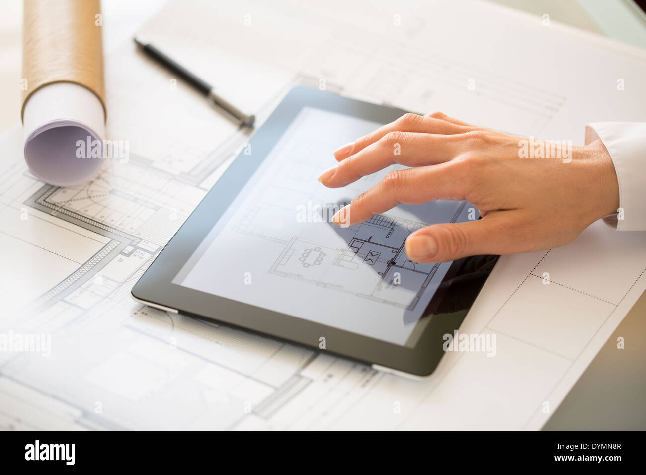 Close-up Of Hands Architect Woman Using Tablet Pc - Stock Image