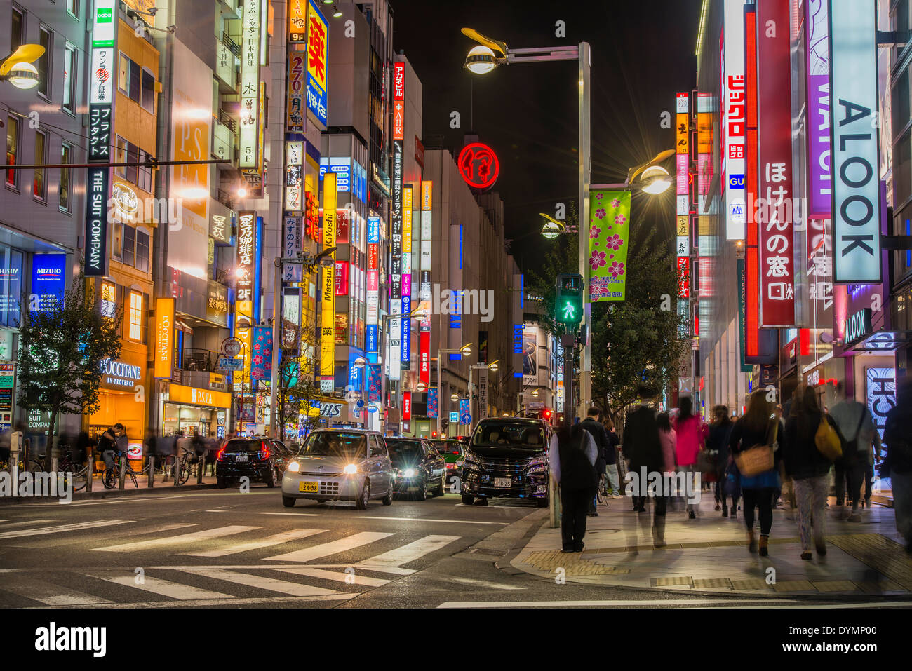Neon lights at night in a street of Shinjuku district, Tokyo, Japan - Stock Image