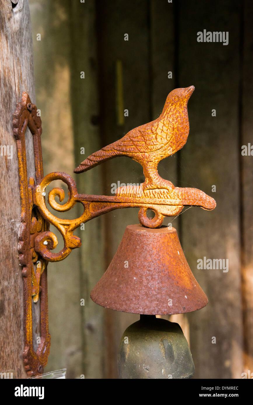 rusty iron bell with bird - Stock Image