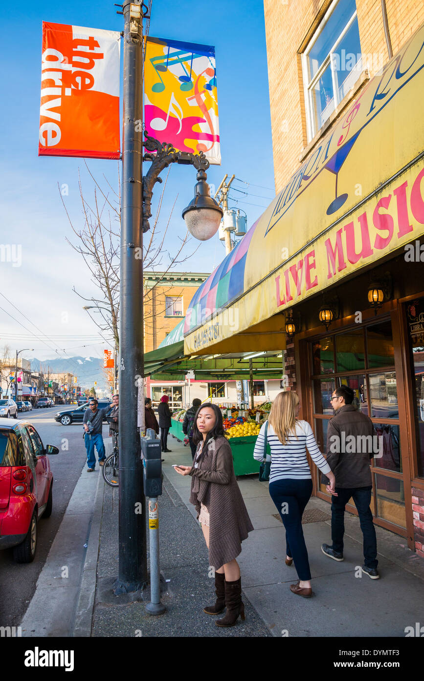 Bustling Commercial Drive neighbourhood,  Vancouver, British Columbia, Canada. - Stock Image