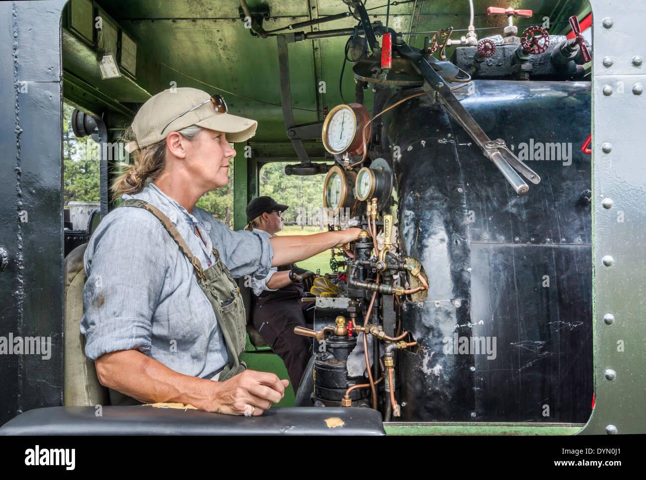 Female locomotive engineers, steam locomotive, before train departure at Fort Steele Heritage Town, British Columbia, Canada - Stock Image