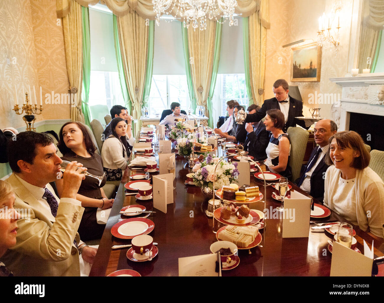 Guests having afternoon tea in a private room at the 5 star Ritz Hotel, Piccadilly, London England UK - Stock Image