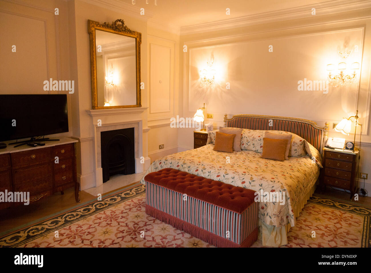 A guest bedroom and bed in a luxury suite, The Ritz Hotel, Piccadilly, London SW1 England UK - Stock Image