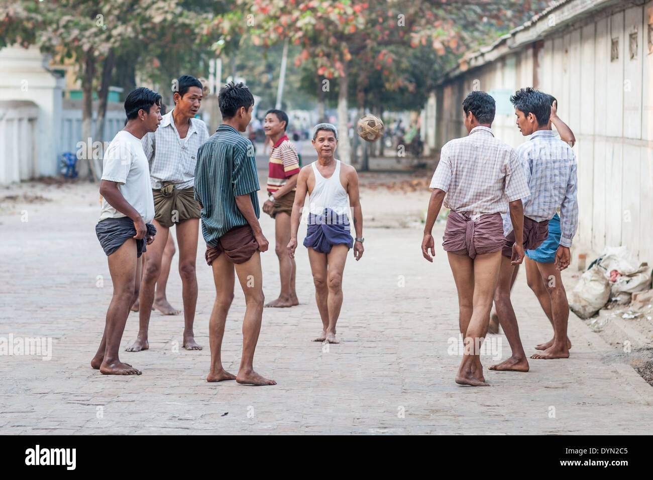 Men playing football Mandalay Myanmar Burma - Stock Image