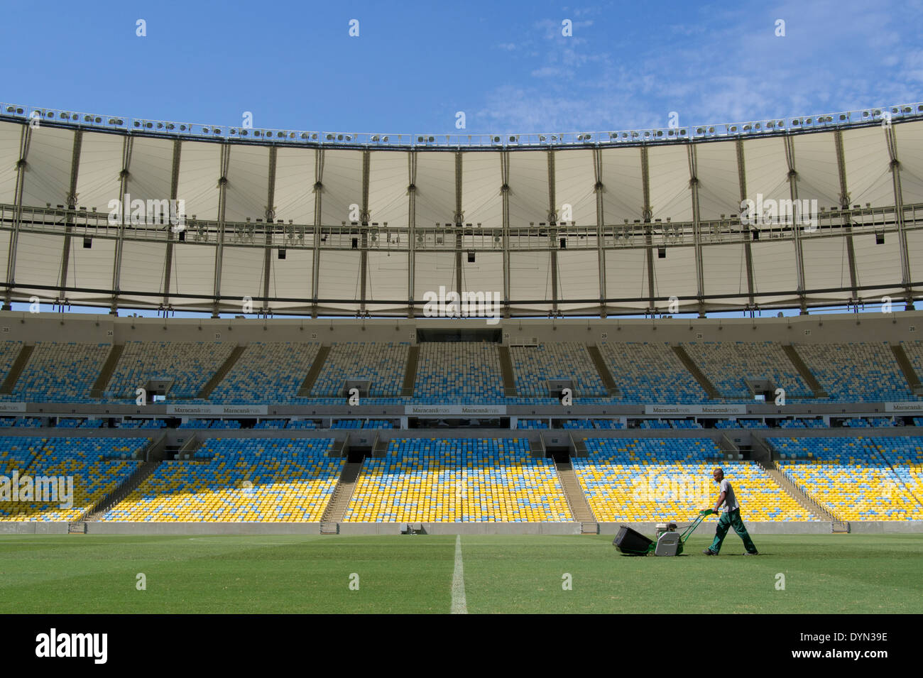 A groundsman prepares the pitch at Maracana stadium in Rio de Janeiro, Brazil, staging the soccer FIFA World Cup Final 2014. - Stock Image