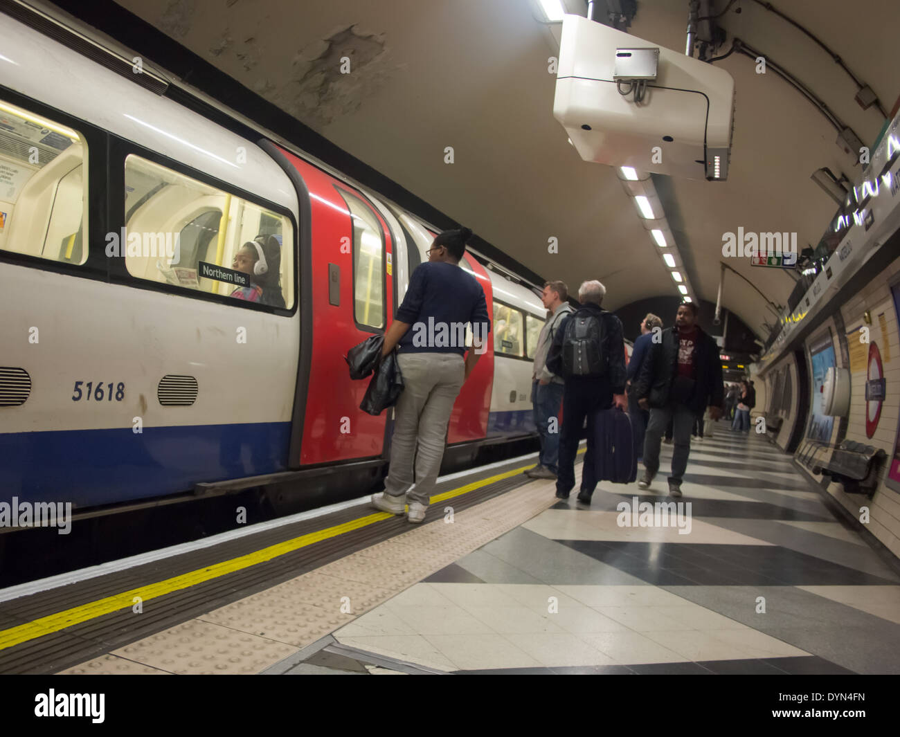 Passengers waiting for the doors to open on a London Underground Northern line train at Waterloo station. - Stock Image