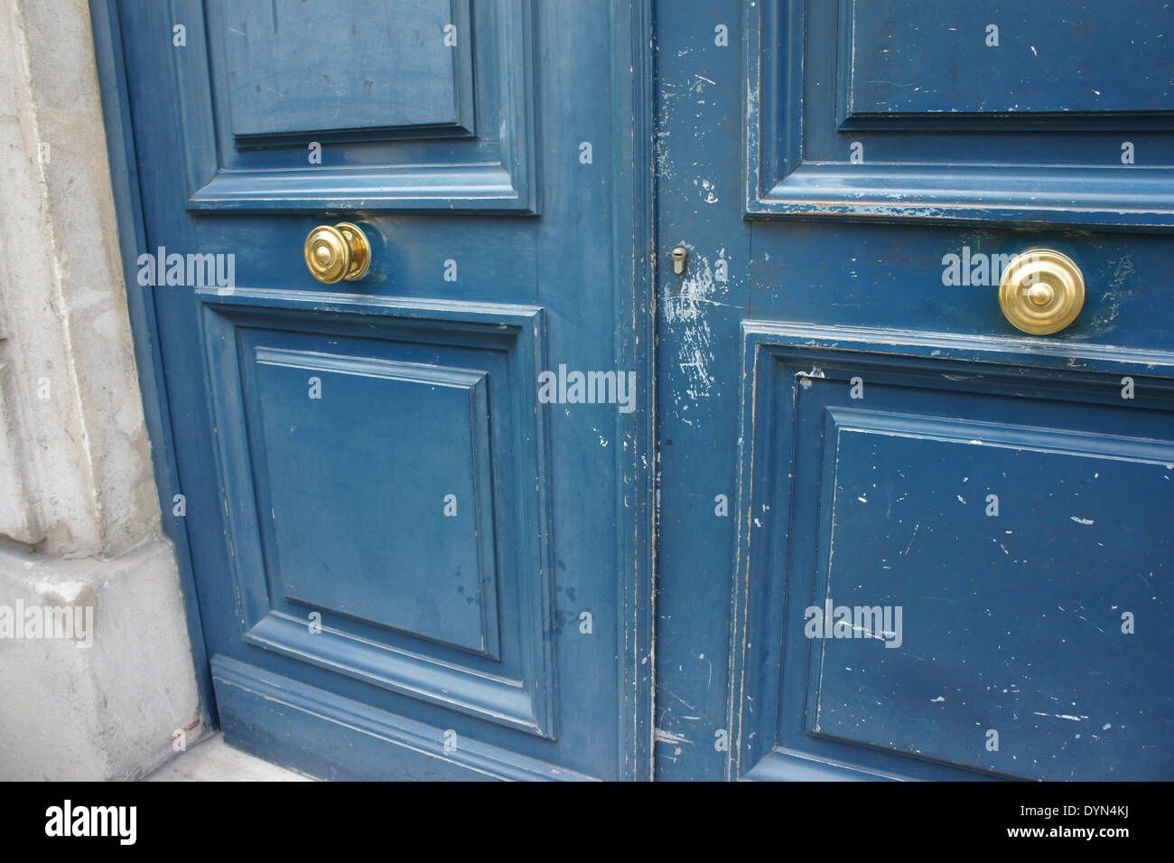 French doors with blue paint and center gold door knobs Stock Photo ...
