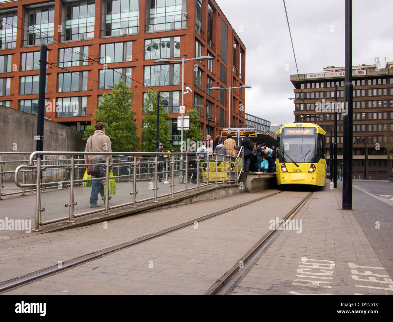 A Manchester metrolink tram at Picadilly gardens station with  access ramp - Stock Image