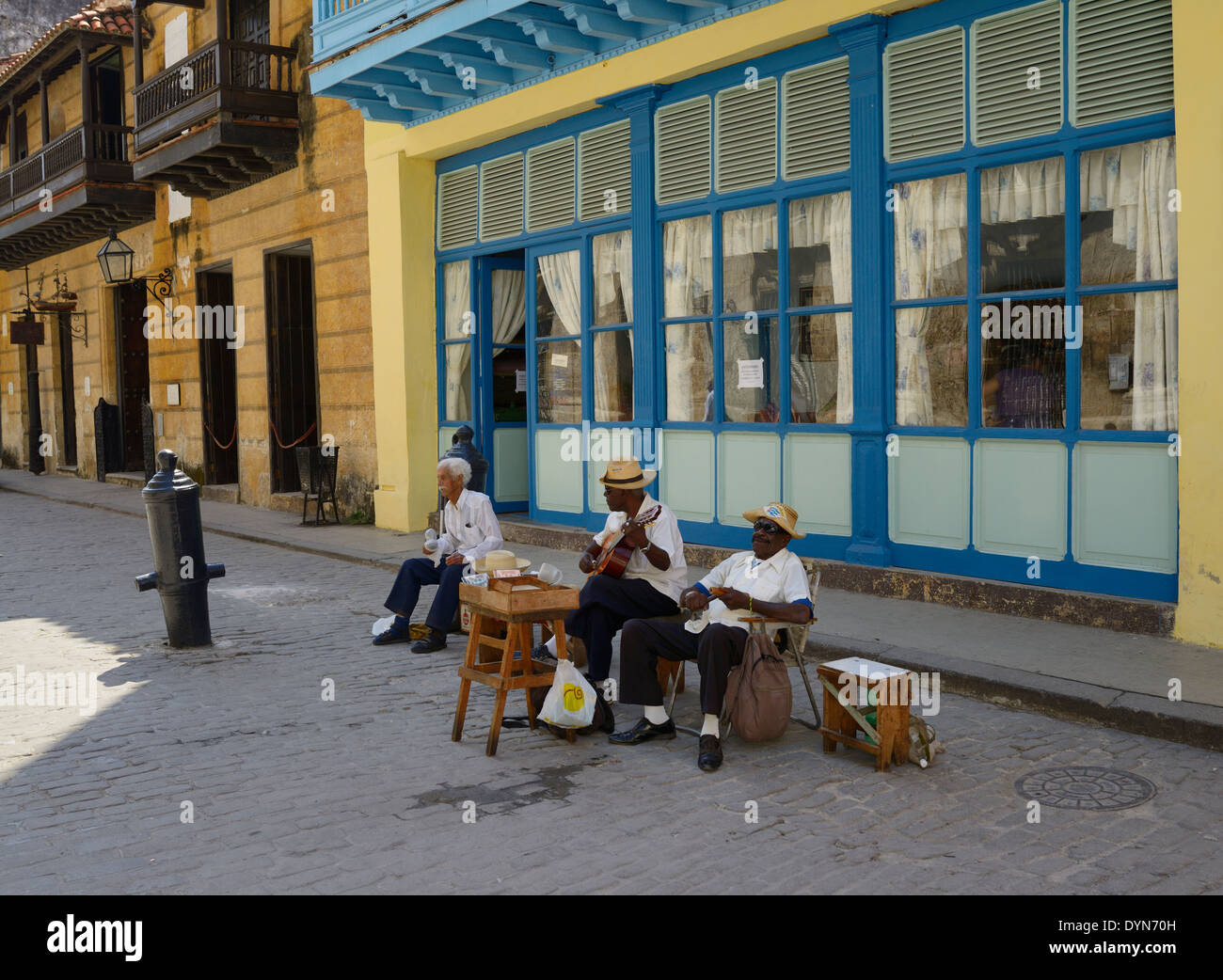 Three older Cuban street musicians playing in Old Havana Cuba near the Governors palace museum - Stock Image