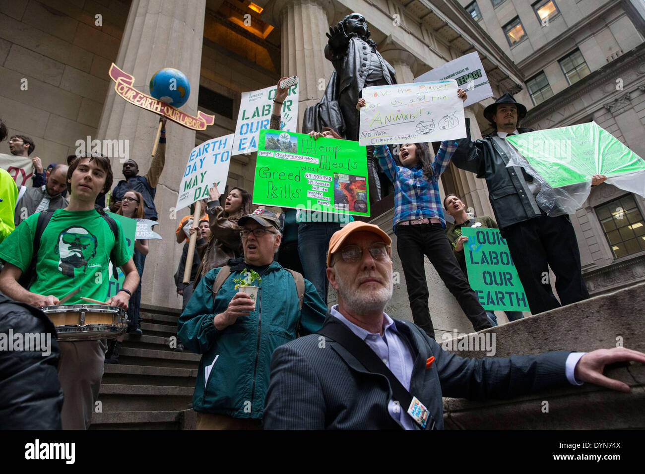 New York, USA. 22nd April 2014. Environmental activists attend a protest in Zuccotti Park on Earth Day. Protesters Stock Photo