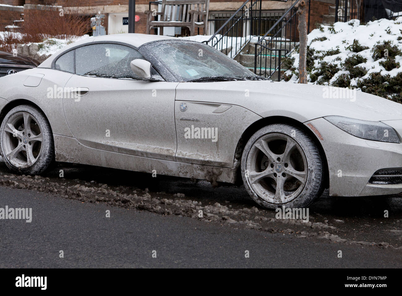 Car covered in dried road salt brine - USA Stock Photo