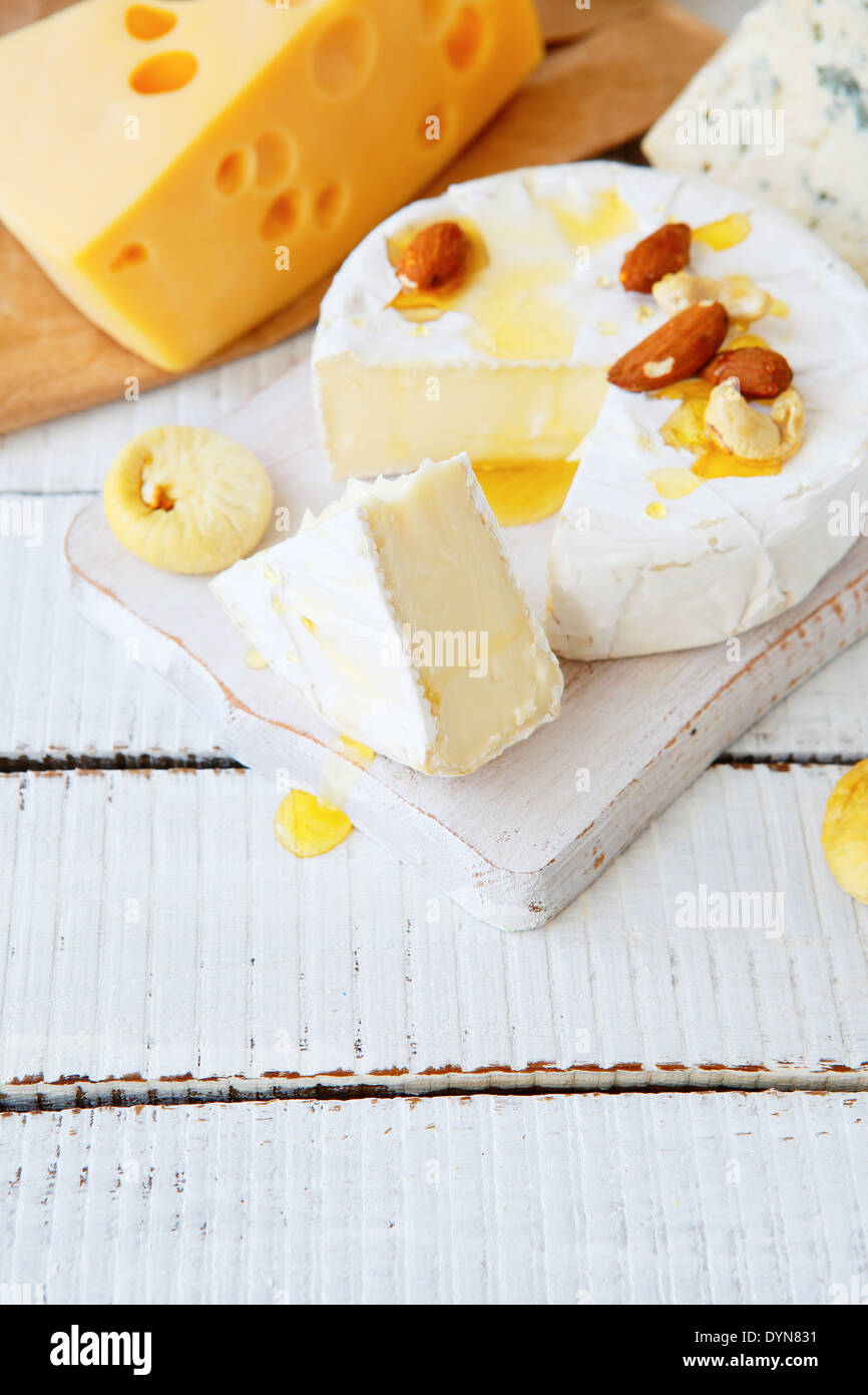 mixed cheese with honey, food closeup - Stock Image